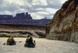 Two Wilderness Inquiry canoes paddle past canyons and buttes on the Green River.