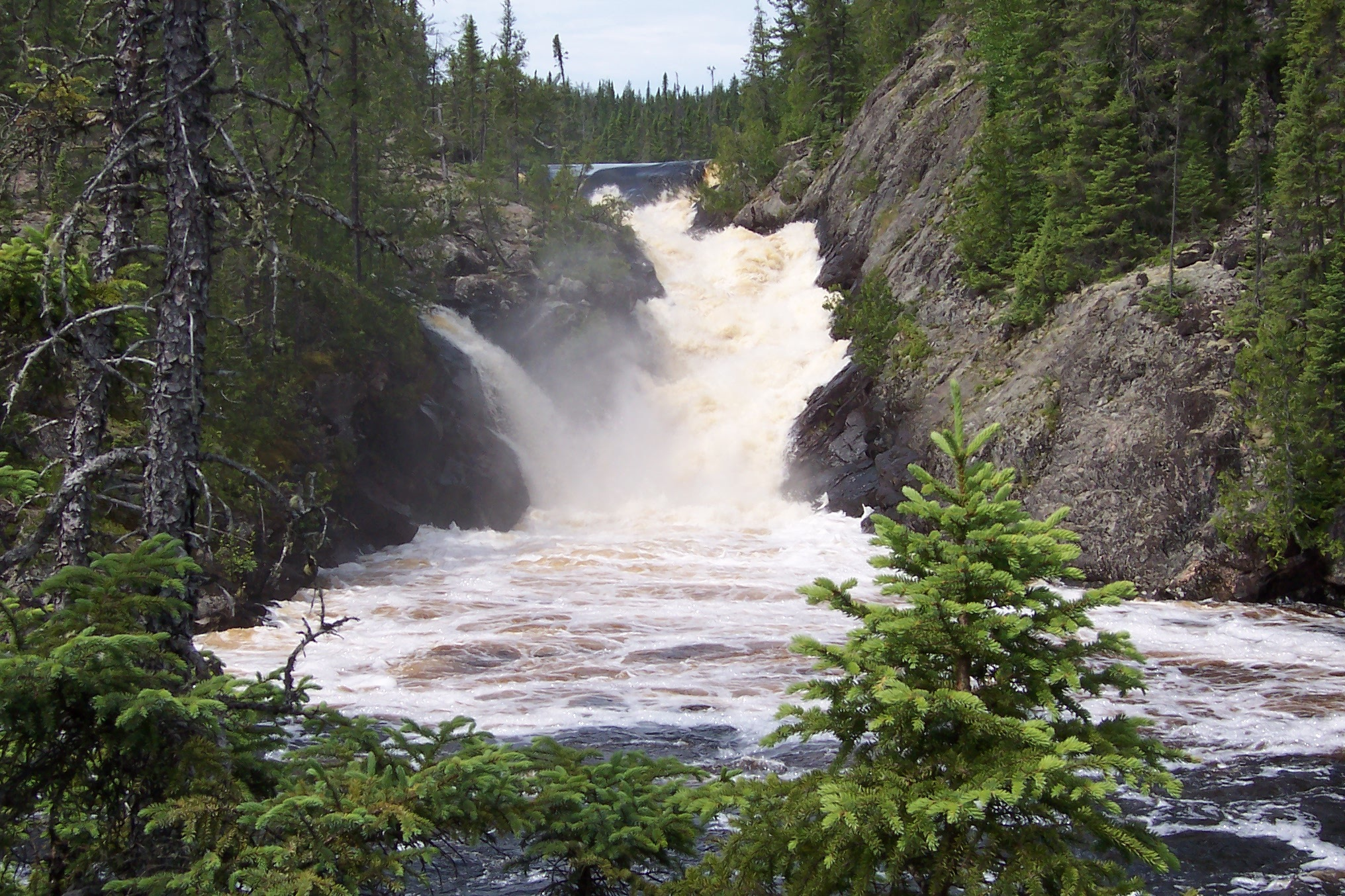 A roaring waterfall cascading down a gorge in the Wabakimi Wilderness.