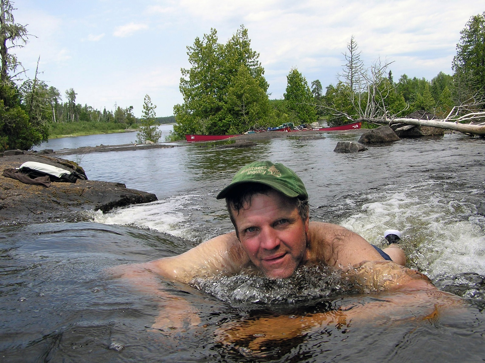 Paul Schurke takes a swim in a small waterfall in a stream in the Wabakimi Provincial Park.