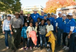 youth, staff and RBC volunteers smile for a group photo
