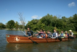 group of students work on their canoeing skills on the water