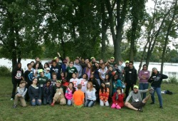 group photo of participants and staff next to the river