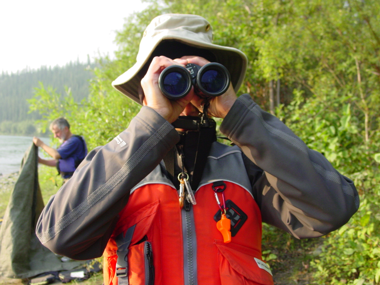 A participant looks through his binoculars to find moose and other wildlife along the Big Salmon River.