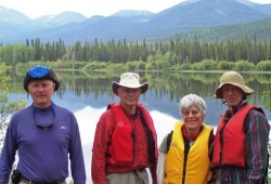 4 participants smiling on the shore of the Big Salmon River